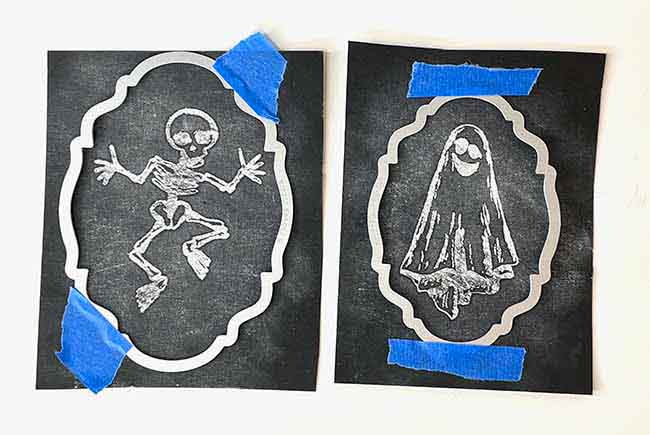 Cut out chalkboard images with shaped dies to make Chalkboard Halloween Ornaments