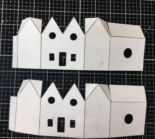 Cut outs of twin gable Christmas putz house cardboard