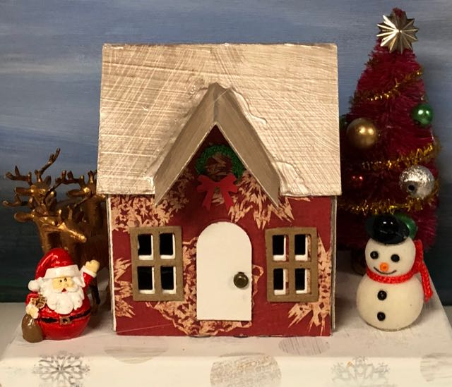 Cute red putz house with santa snowman, reindeer heard, red tree