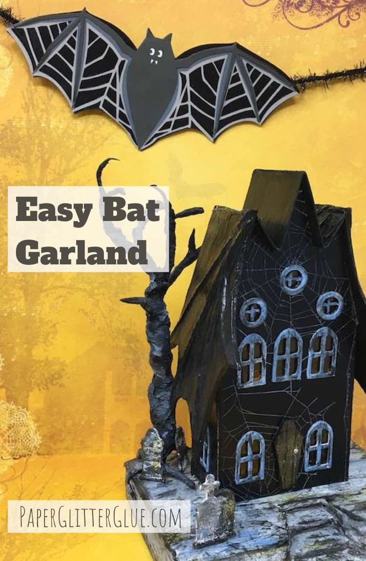 DIY Easy Bat Garland shown with the bat wing house