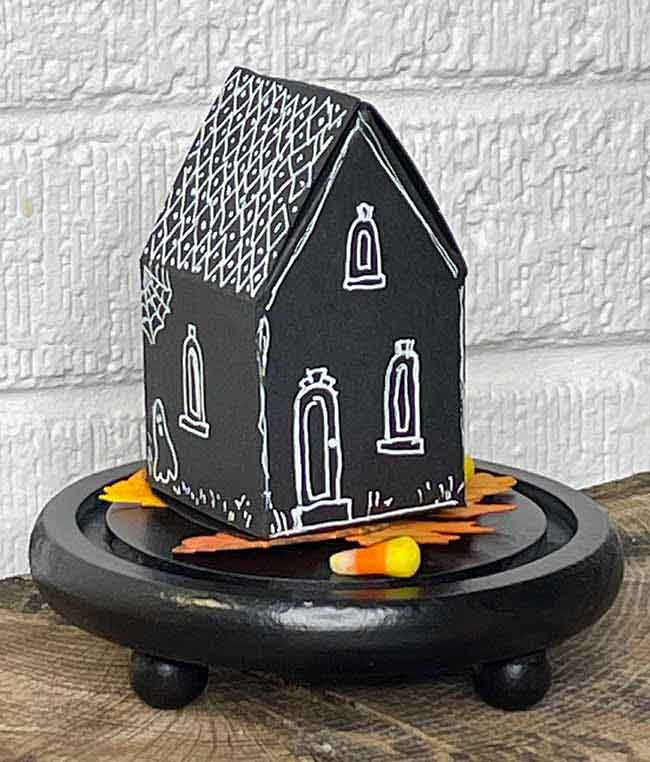 DIY paper house treat box decorated with white gel pen