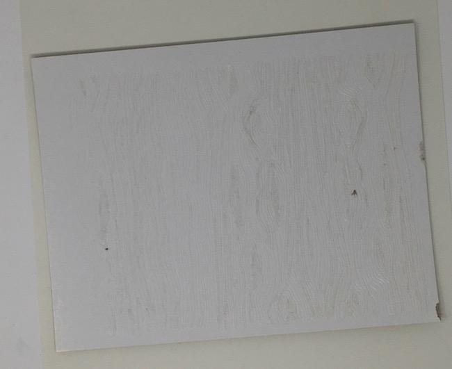 Debossed texture on white coated cardboard