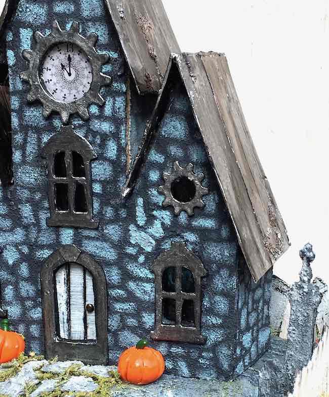 Distressed windows on miniature Halloween House
