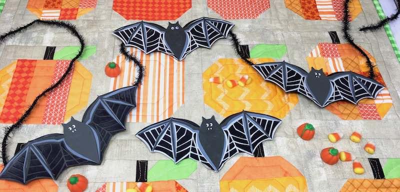 Easy Bat garland on pumpkin quilt