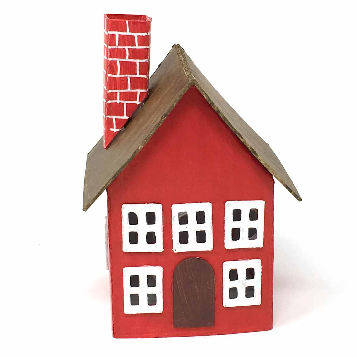 Tiny paper house painted in red with brown roof and red chimney