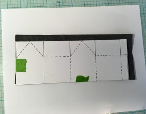 Transfer miniature house pattern to cardboard using carbon paper
