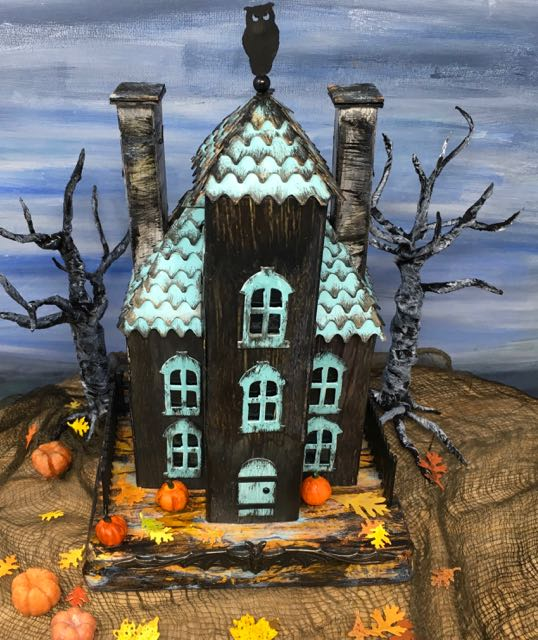 Ebonywood Mansion paper house with fall leaves