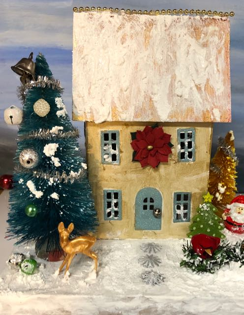 Elegant gold putz house with deer and santa and red bird