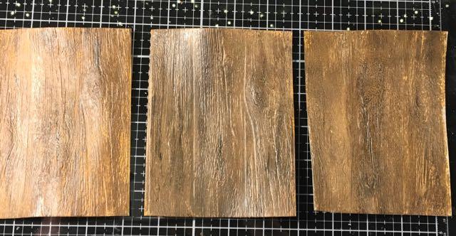 Embossed cardboard painted to mimic wood