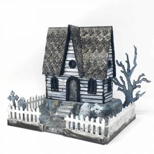 Funky Halloween house with steep roof and embossed shingles.