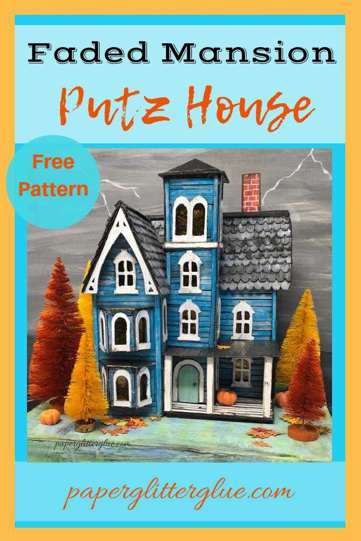 Faded Mansion Putz House paper house dressed up for Fall decor with fall colored bottlebrush trees