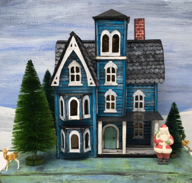 Faded Mansion Putz House with Christmas decor bottlebrush trees Tim Holtz Salvaged Santa and deer