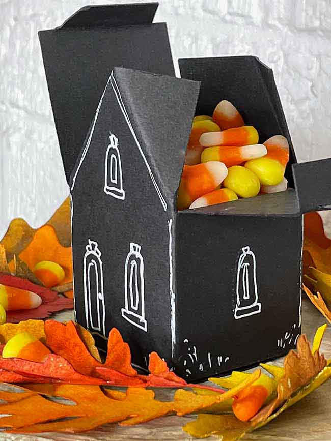 Fill Halloween Paper House treat box with candy corn