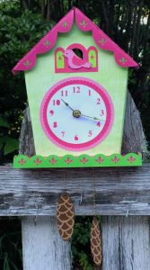 Finished clock on old wooden fence