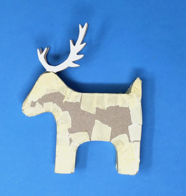 First side reindeer pinata candy box taped masking tape