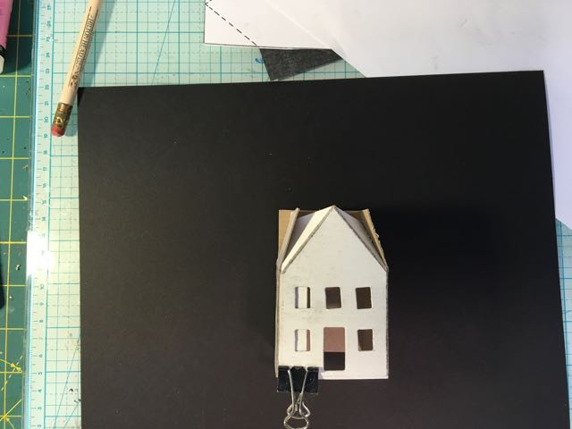 The glue tab on the paper house should be in the back to hide better.