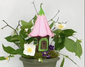 Flower top Fairy house in mossy pot