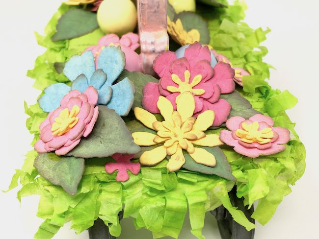 Paper flowers on Easter bunny decoration pull toy