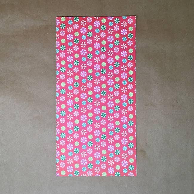 Fold scrapbook paper in half