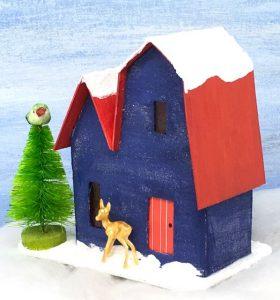 Front Christmas Putz house no 1 angled gold deer, green bottlebrush tree