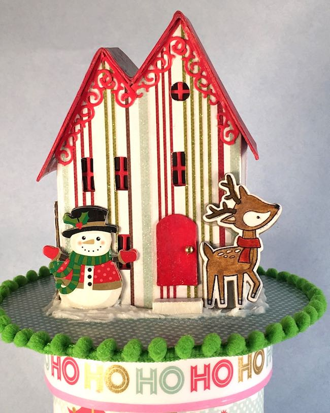 Front of little Christmas Putz house on ribbon roll