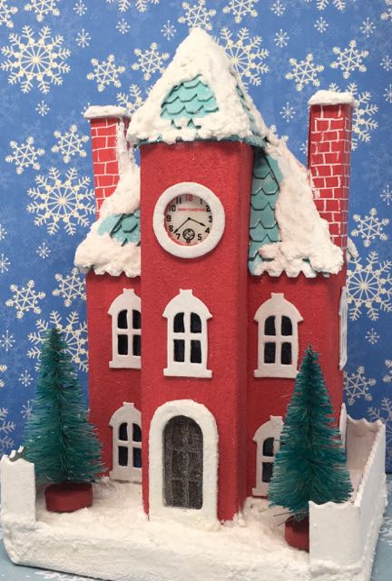 Kelly's Christmas Clockhouse Putz house front view with glitter and snowy details #putzhouse #paperhouse #papercraft