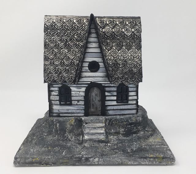 The little paper Haunted Halloween House perched on its painted base