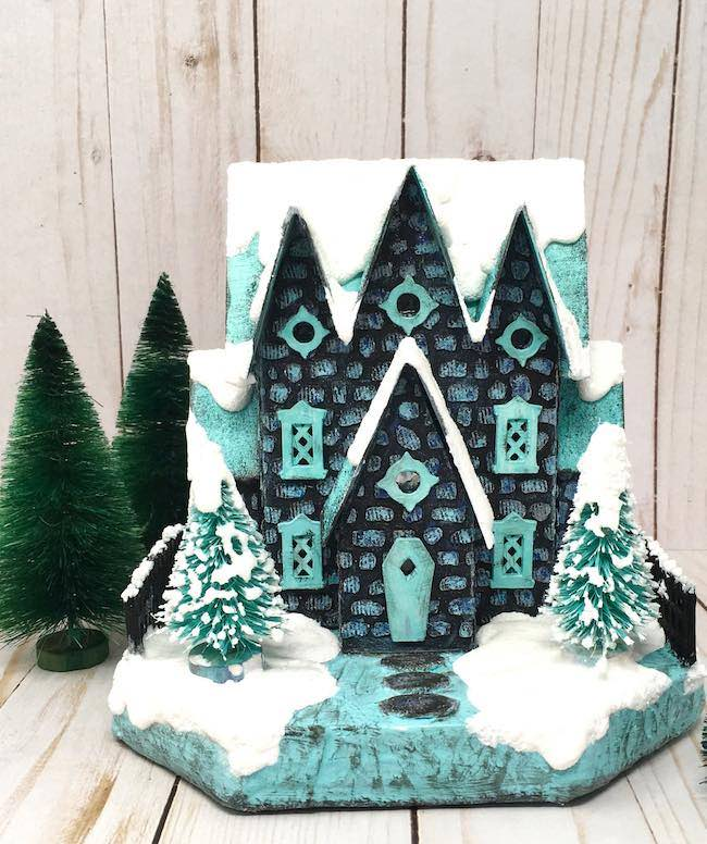 Frost-covered stone stenciled miniature cardboard house