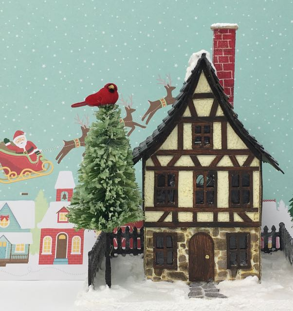 German half-timbered Christmas Putz house with a handmade bottle brush tree