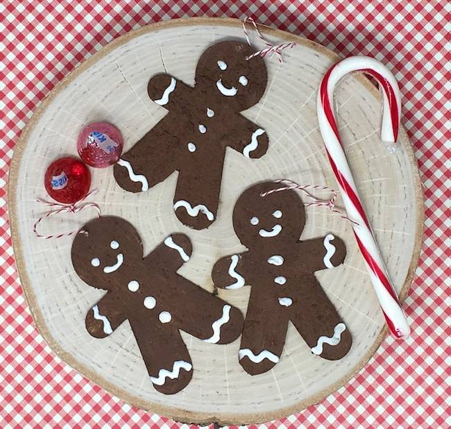 Gingerbread man ornaments made with gingerbread paint