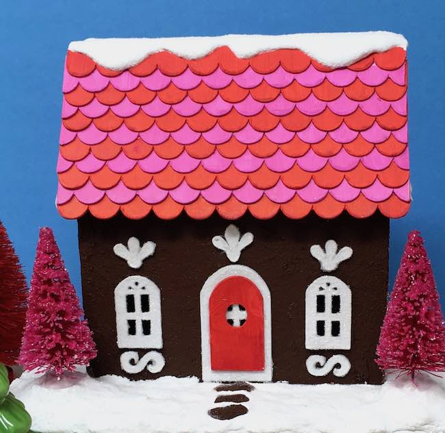 Gingerbread paper house bright colors scalloped roof
