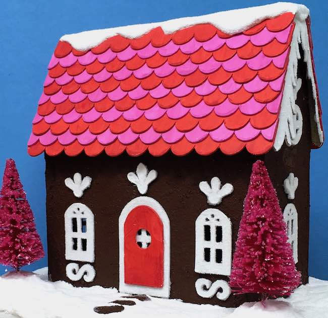 Gingerbread paper house with bright trees icicles