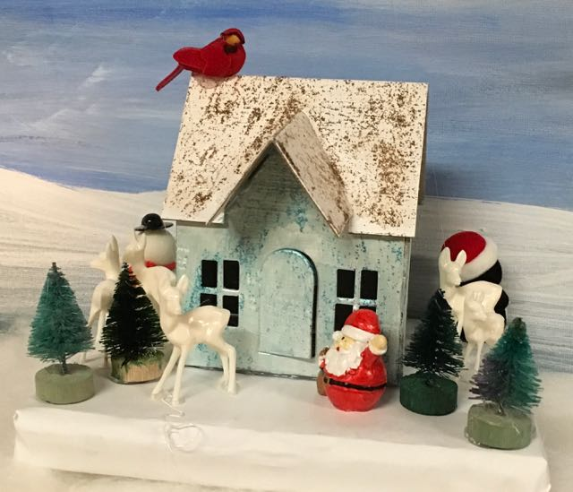 Glitter painted Putz house with red bird and forest