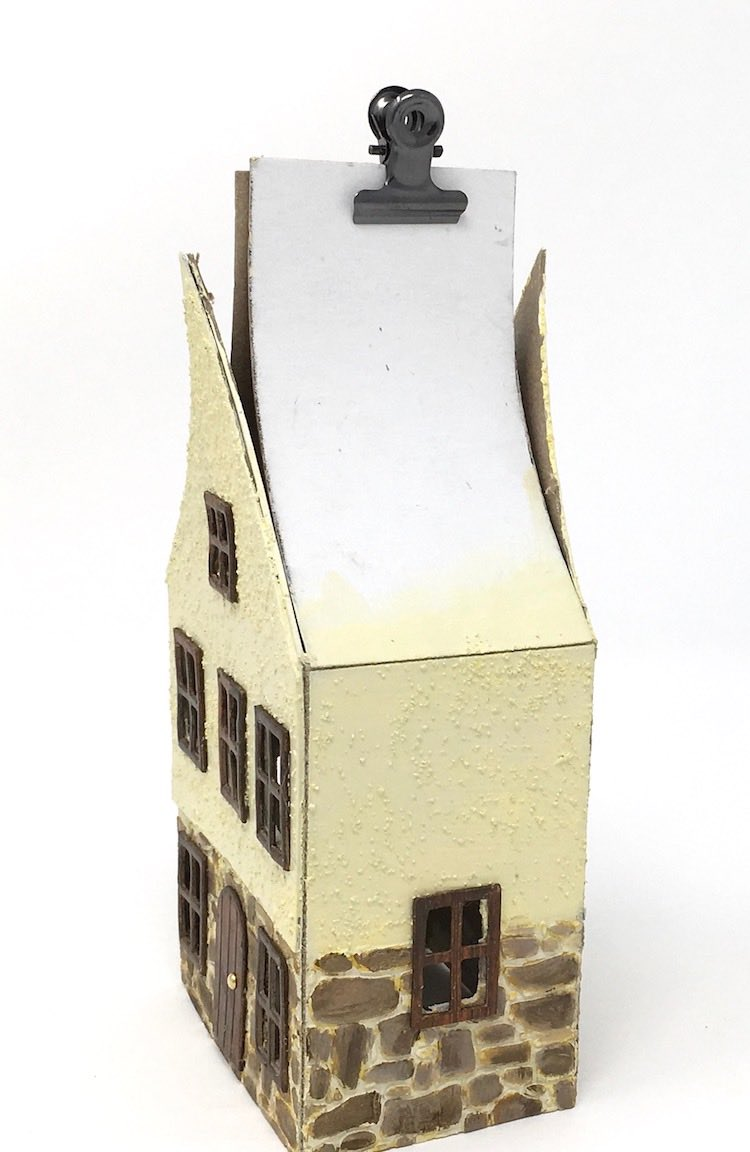 Glue roof flaps to Christmas village German half timbered house