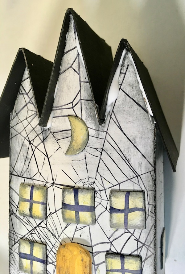 Glue roof pieces on triple gable gothic halloween paper house