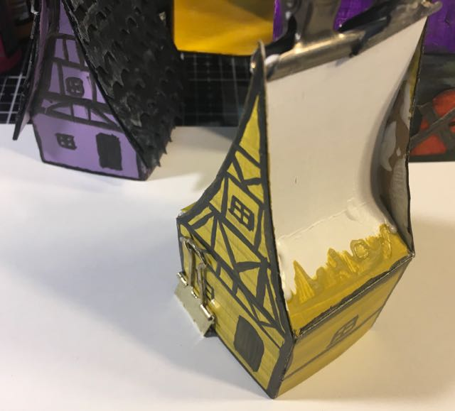 Glue roof tabs behind gables Medieval Haunted Paper house