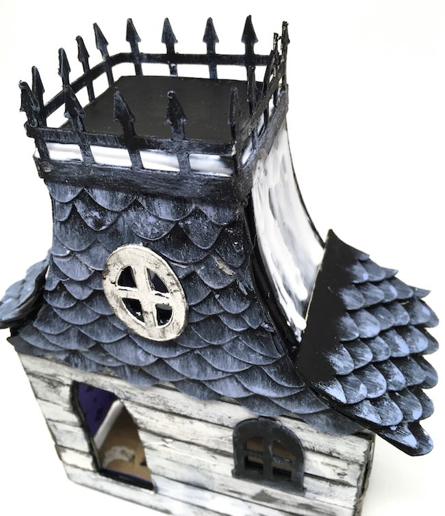 Glue shingles on spooky miniature house