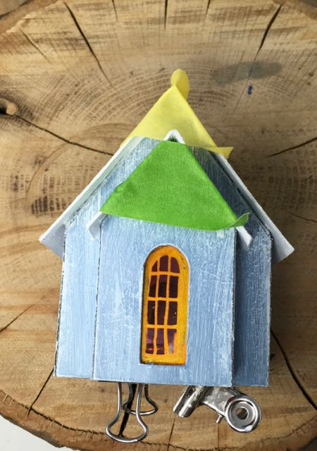 Glue that roof down on the snowy church with front portico and gold door paper house