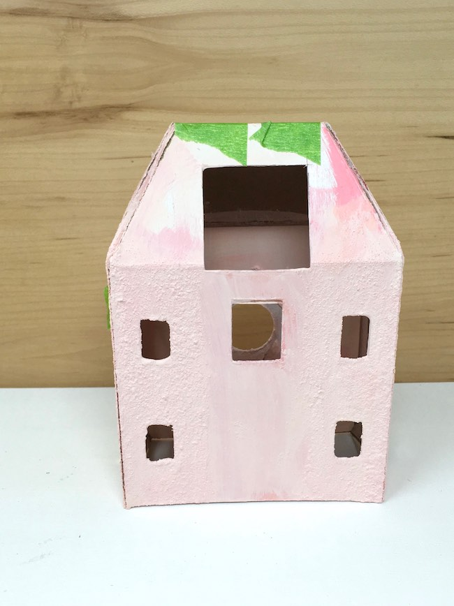 Gluing paper house together