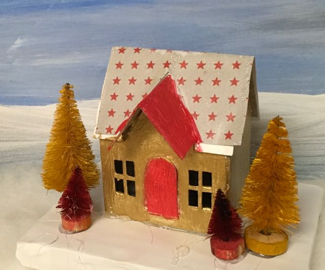 Gold Putz house with yellow and red trees