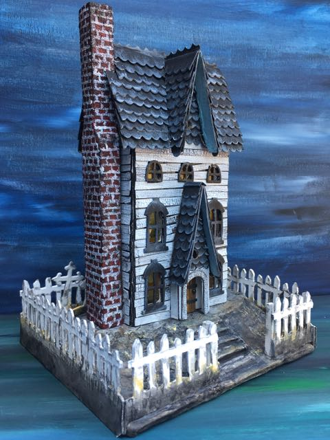 Gothic Halloween paper house showing the elongated chimney #putzhouse #paperhouse #halloweendecor