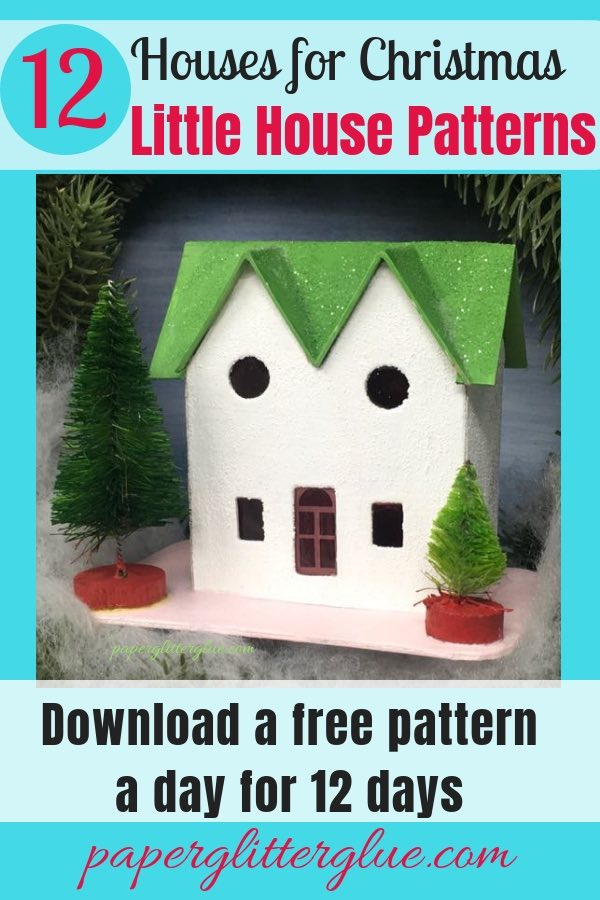 Green Roof Twin Gable Christmas Putz house with Bottle brush trees decorating a wreath