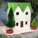Green twin gable house in Christmas wreath
