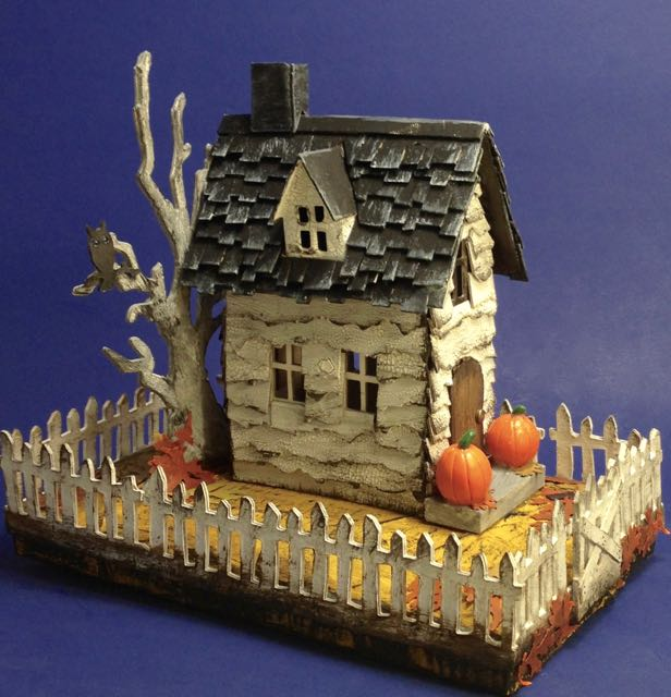 View of the distressed, crackle siding on the Halloween Village Brownstone paper house