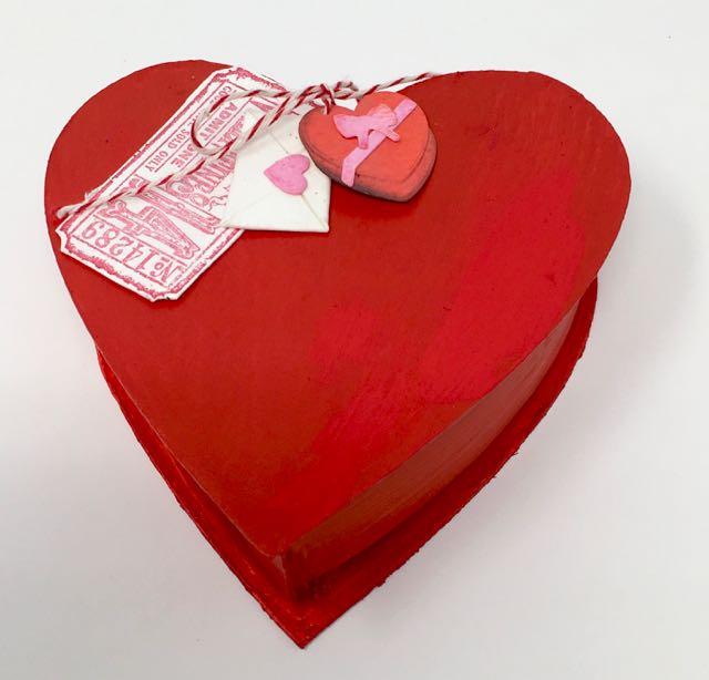Heart candy box decorated with Tim Holtz ticket treats