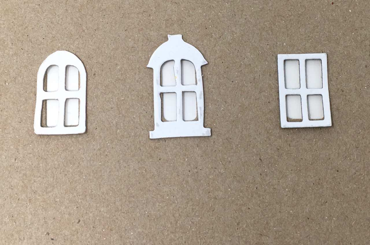 How the Tim Holtz windows fit on the cutouts from the dies