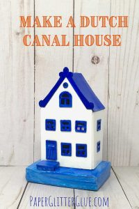 Small blue and white cardboard house based on the Canal Houses in Holland