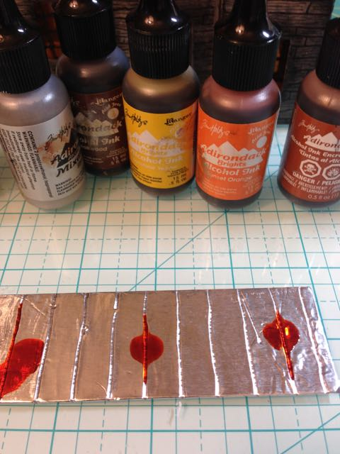 Lighter alcohol ink colors first for the rusted tin roof