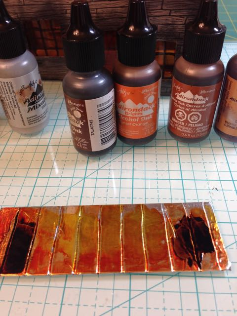 Add darker alcohol ink colors to rusted roof