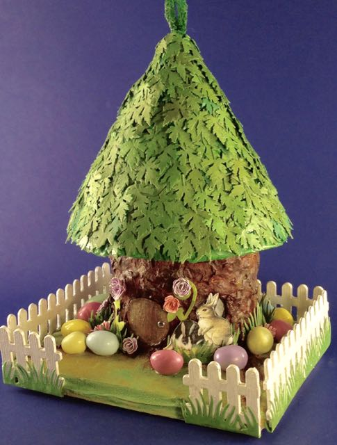 Easter house on a tree stump base #putzhouse #Easter #papercraft